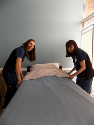 Personal Support Worker students learning to properly make a bed